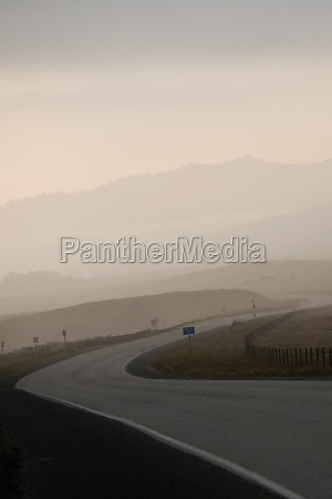empty stretch of road at dusk