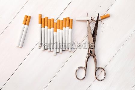 cutting cigarettes by scissors