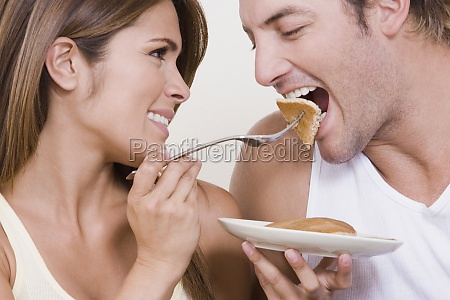 young woman feeding breakfast to a