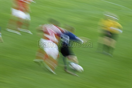 soccer players playing soccer in a