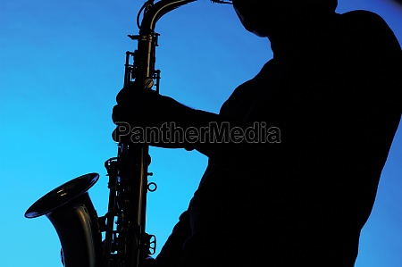 silhouette of a musician playing the