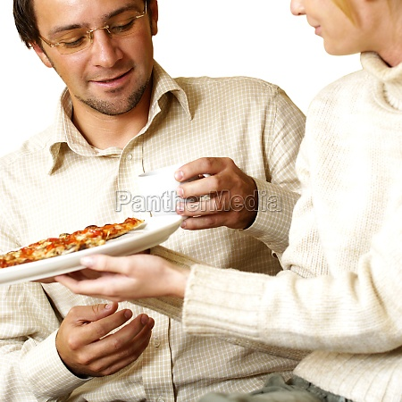 businesswoman offering pizza to a businessman