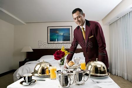 waiter serving food