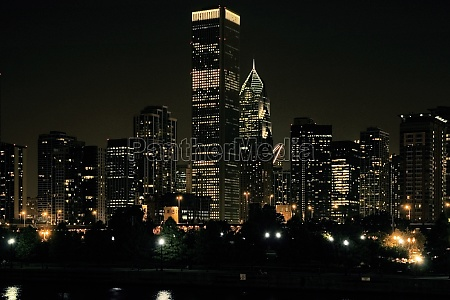 buildings lit up at night chicago