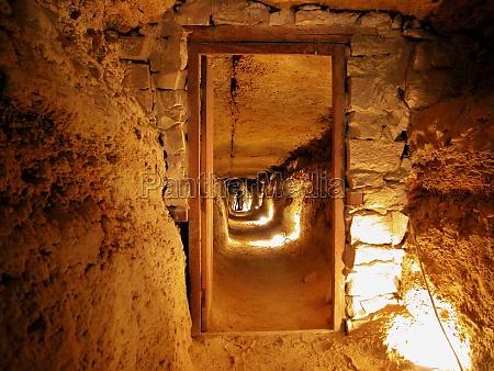 tourists inside an old building saqqara