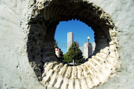 skyscrapers viewed through a hole in
