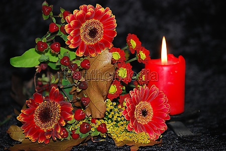 autumn flowers and candlelight