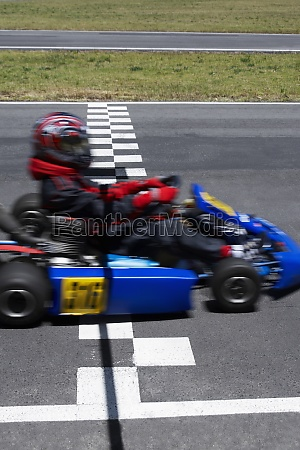 go cart racer crossing the finish