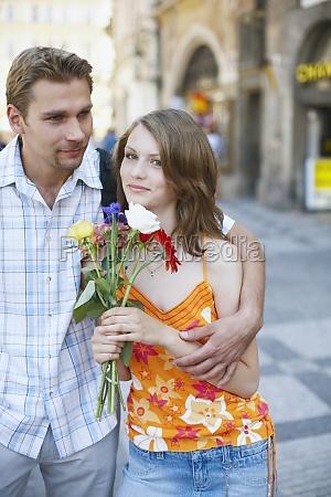 teenage boy embracing a teenage girl
