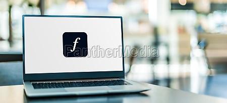 laptop computer displaying logo of adobe