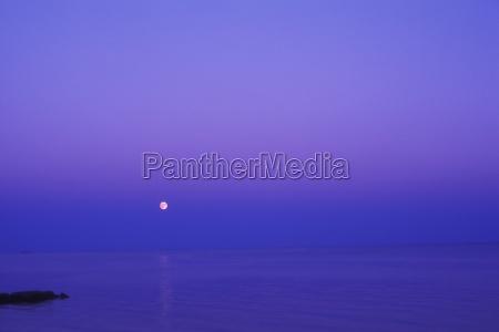 moon shining over the sea cape