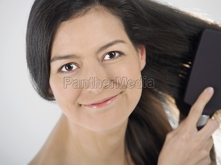 portrait of a young woman brushing