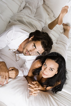 portrait of a young couple lying