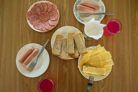 table with breakfast of sausage cheese