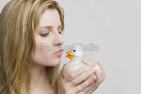 closeup of a teenage girl kissing