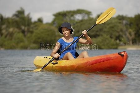 teenage girl kayaking