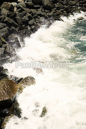 waves crashing on a rock formation