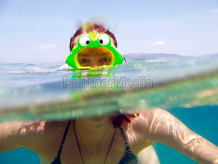 diving with diving goggles in the