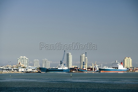 container ships moored at a harbor
