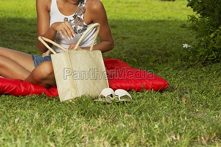 young woman holding a bag