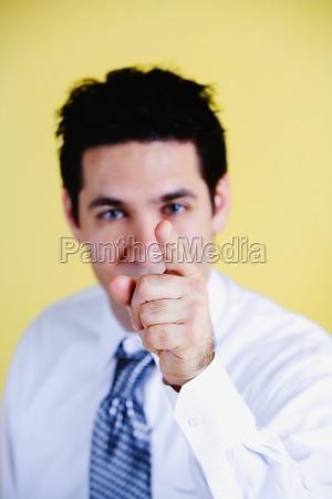 portrait of a businessman pointing forward