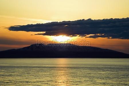 sunset over an island fire island