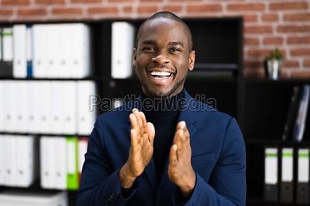 african american business man applauding