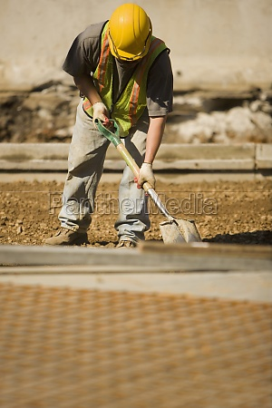 construction worker using a shovel at