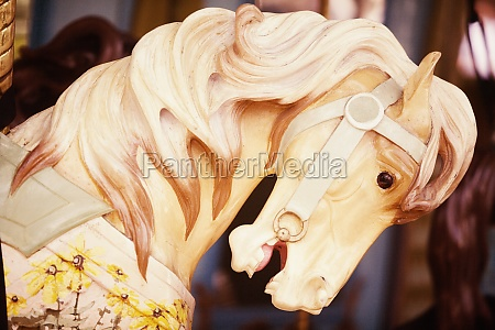 close up of a carousel horse