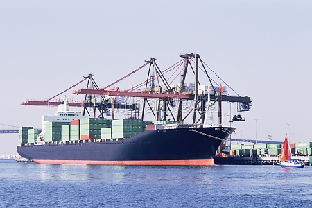 container ship being loaded at the