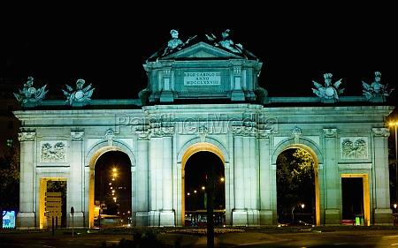 memorial gate lit up at night