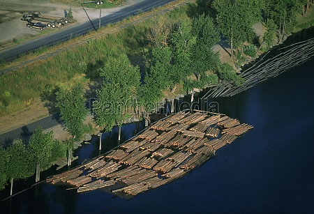 log rafts flowing to a sawmill