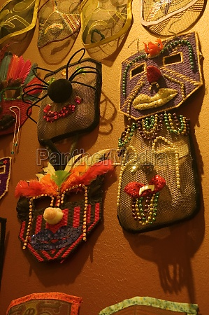 close up of masks hanging on