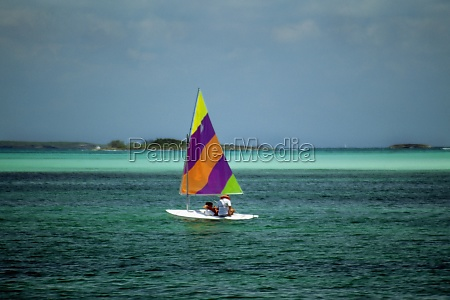 a colorful sailboat on the tranquil