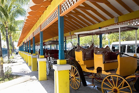 horse carts in a parking lot
