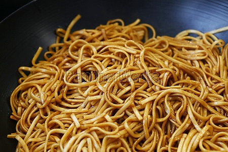 close up asian fried noodles in