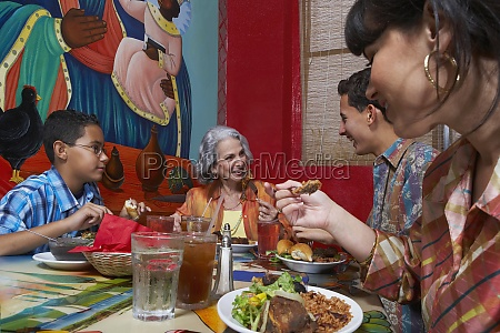 three generation family taking food in