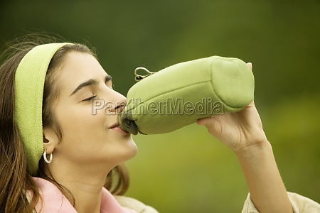 side profile of a girl drinking