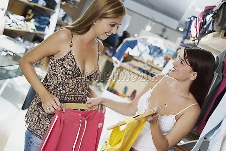 closeup of two young women choosing