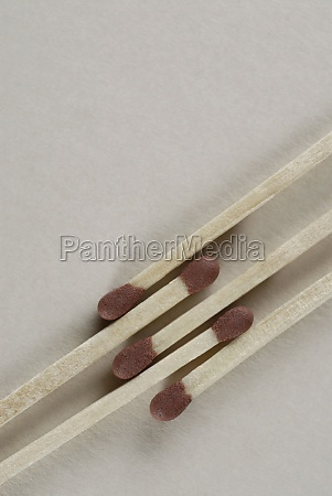 closeup of five matchsticks
