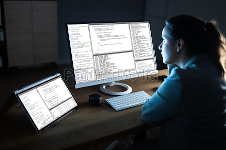 software programmer coder working on computer