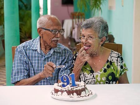 elder couple celebrating mans 91 st