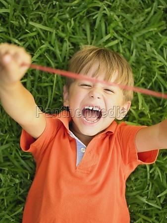 closeup of a boy stretching a