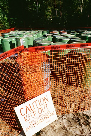warning sign in front of barrels