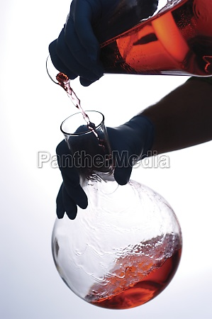 close up of a person pouring