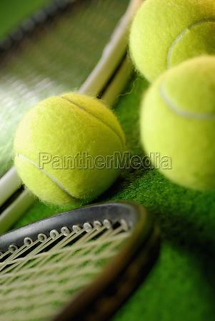 close up of three tennis balls