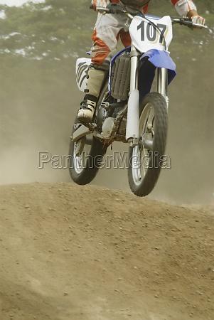motocross rider riding a motorcycle