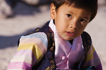 close up of a boy looking
