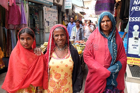 three indian women with colorful veil