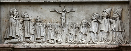 an old crucifixion relief sculpture outside